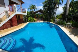 Four Bedroom Ocean View Home in Guiones EE Section – Move In Ready or Renovation Project with Tons of Potential-SOLD